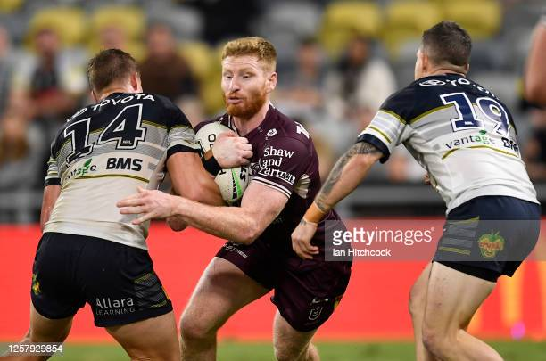 Brad Parker of the Sea Eagles is tackled during the round 11 NRL match between the North Queensland Cowboys and the Manly Warringah Sea Eagles at...