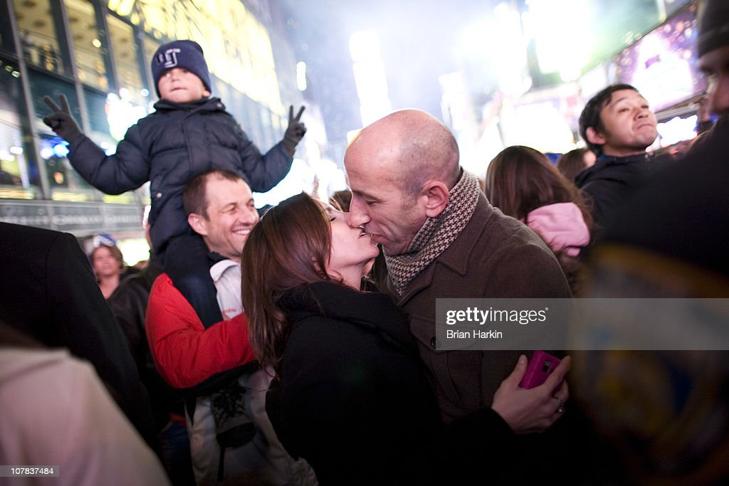 Brad Pass (R) and Patricia Zima, both of Manhattan, kiss in Times Square just after the annual ball drop January 01, 2011 in New York City. This year a 11,875-pound Waterford crystal ball descended a 141-foot tall flagpole to mark the beginning of 2011.