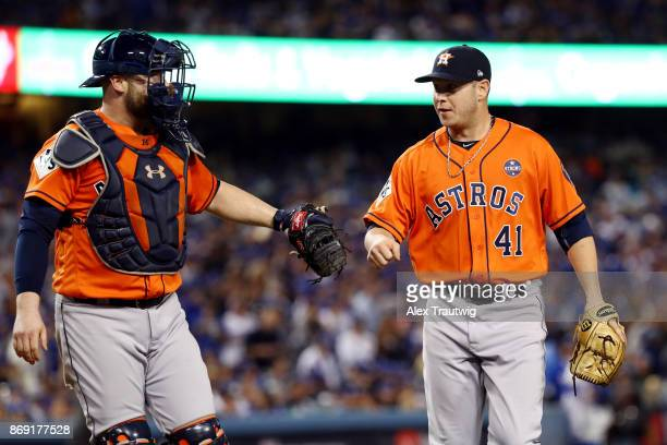 Brad Peacock of the Houston Astros and Brian McCann walk back to the dugout after the third inning during Game 7 of the 2017 World Series against the...