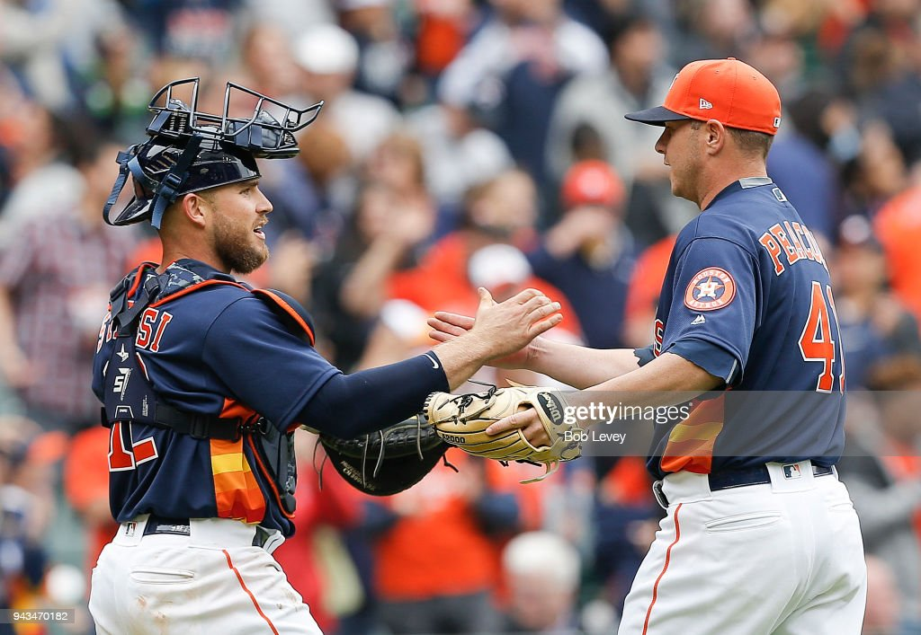Brad Peacock #41 of the Houston Astros shakes hands with Max Stassi #12 after the final out against the San Diego Padres at Minute Maid Park on April 8, 2018 in Houston, Texas.
