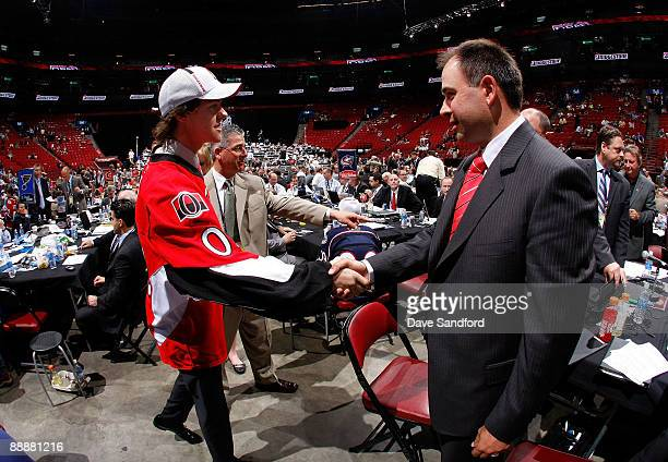 Brad Peltz shakes the hand of a member of the Ottawa Senators organization after being drafted in the second day of the 2009 NHL Entry Draft at the...