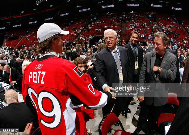 Brad Peltz shakes the hand of General Manager Bryan Murray of the Ottawa Senators organization after being drafted in the second day of the 2009 NHL...