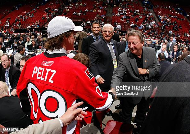 Brad Peltz shakes the hand of Owner Eugene Melnyk of the Ottawa Senators organization after being drafted in the second day of the 2009 NHL Entry...