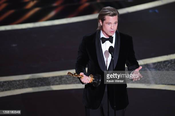 Brad Pitt accepts the Actor in a Supporting Role award for 'Once Upon a Timein Hollywood' onstage during the 92nd Annual Academy Awards at Dolby...