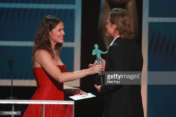 Brad Pitt accepts the Outstanding Performance by a Male Actor in a Supporting Role award for 'Once Upon a Time in Hollywood' from Jennifer Garner...
