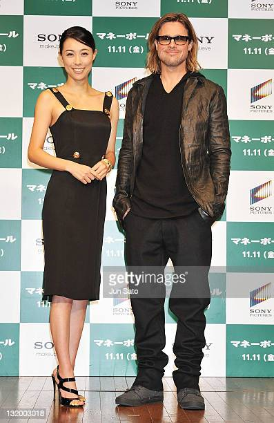 Brad Pitt and actress Kazue Fukiishi attend the press conference of 'Moneyball' at the Grand Hyatt on November 10 2011 in Tokyo Japan The film will...