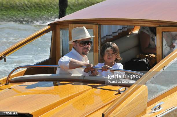 Brad Pitt and adopted son Pax Thien JoliePitt take a water boat from Marco Polo Airport in Venice ahead of the 65th Venice Film Festival on August 26...
