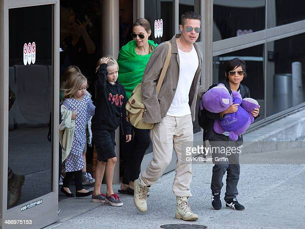 Brad Pitt and Angelina Jolie are seen after landing at Los Angeles International Airport with their children Pax JoliePitt Shiloh JoliePitt Vivienne...