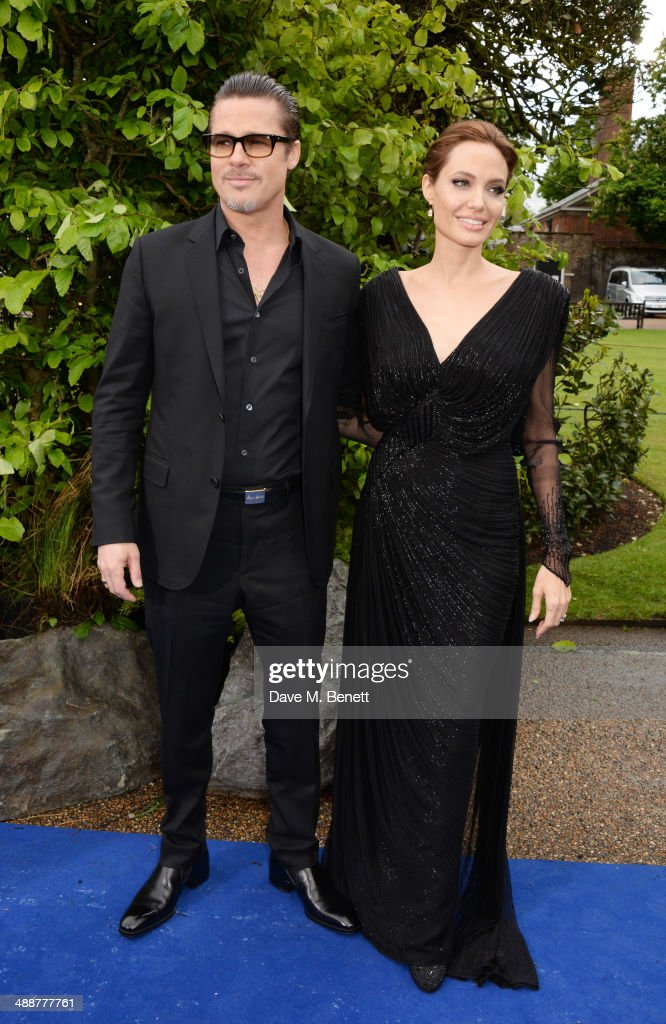 Brad Pitt (L) and Angelina Jolie arrive at a private reception as costumes and props from Disney's 'Maleficent' are exhibited in support of Great Ormond Street Hospital at Kensington Palace on May 8, 2014 in London, England.
