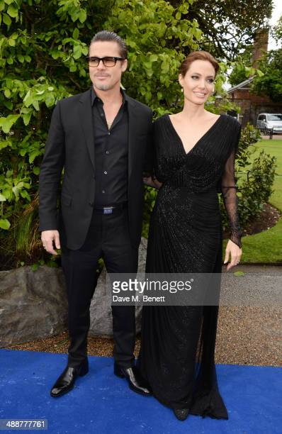 Brad Pitt and Angelina Jolie arrive at a private reception as costumes and props from Disney's 'Maleficent' are exhibited in support of Great Ormond...