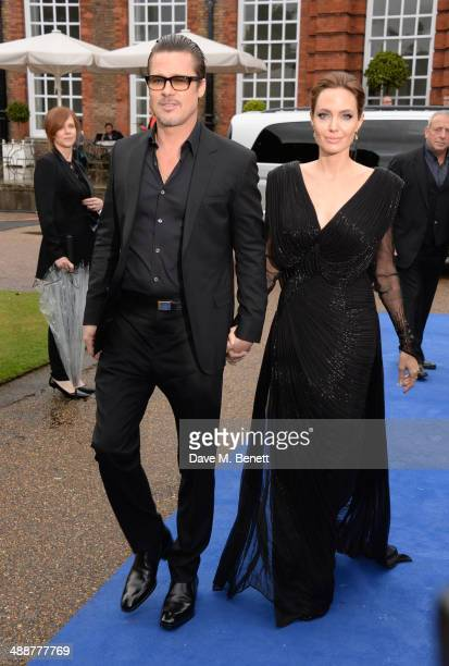 """Brad Pitt and Angelina Jolie arrive at a private reception as costumes and props from Disney's """"Maleficent"""" are exhibited in support of Great Ormond..."""