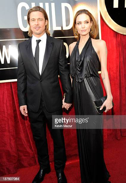 Brad Pitt and Angelina Jolie arrive at The 18th Annual Screen Actors Guild Awards broadcast on TNT/TBS at The Shrine Auditorium on January 29 2012 in...