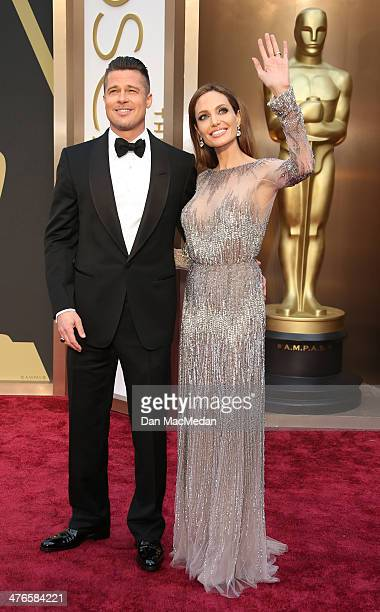 Brad Pitt and Angelina Jolie arrive at the 86th Annual Academy Awards at Hollywood Highland Center on March 2 2014 in Los Angeles California