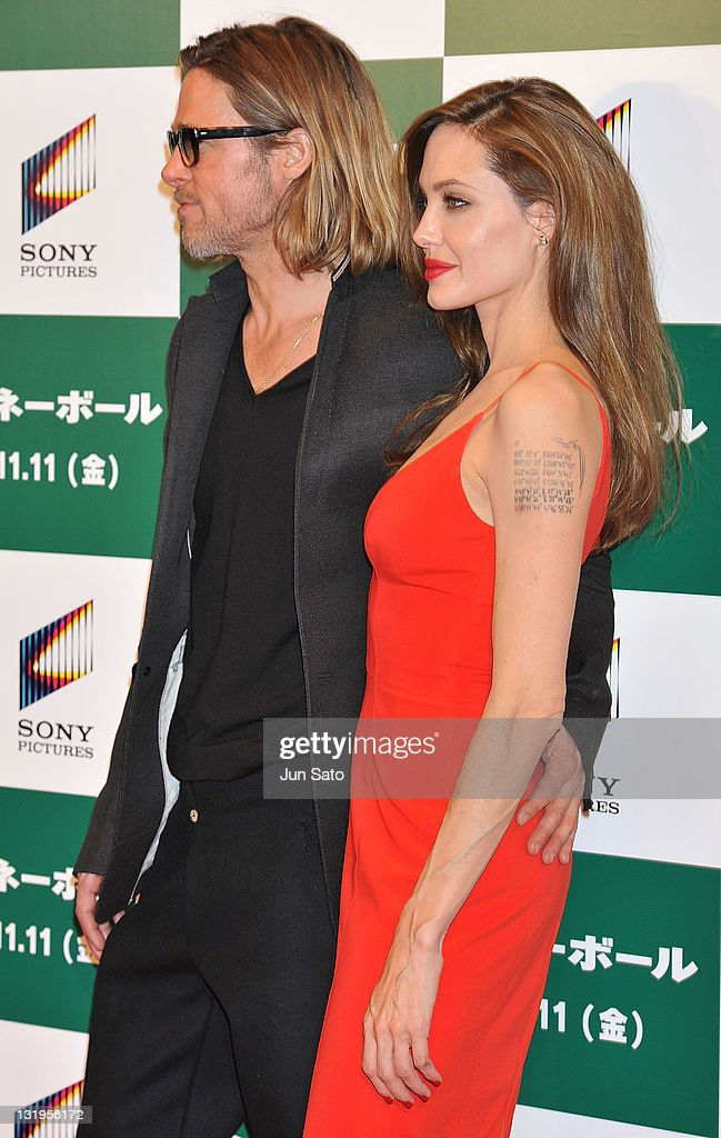 Brad Pitt and Angelina Jolie arrive at the premier of 'Moneyball' at Tokyo International Forum on November 9, 2011 in Tokyo, Japan. The film will open on November 11 in Japan.
