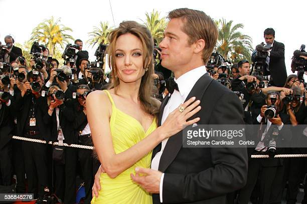 Brad Pitt and Angelina Jolie arrive at the premiere of 'Ocean's 13' during the 60th Cannes Film Festival