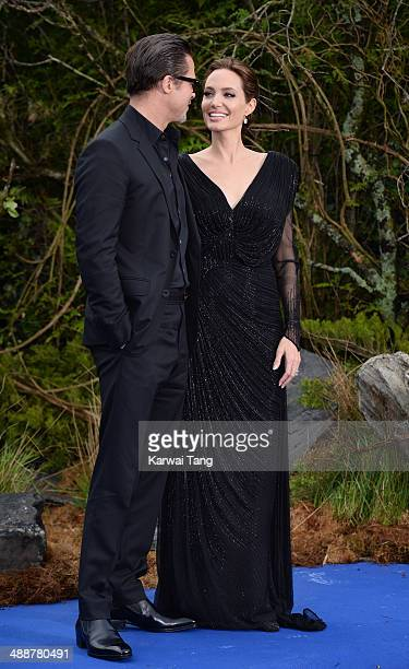 """Brad Pitt and Angelina Jolie attend a private reception as costumes and props from Disney's """"Maleficent"""" are exhibited in support of Great Ormond..."""