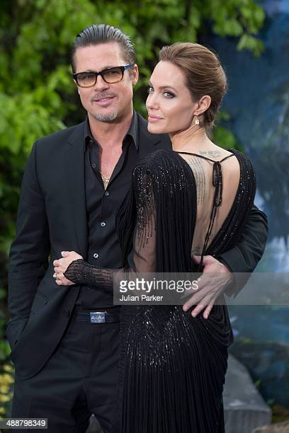 Brad Pitt and Angelina Jolie attend a private reception as costumes and props from Disney's Maleficent are exhibited in support of Great Ormond...