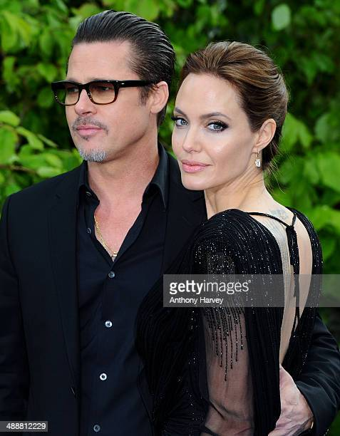 "Brad Pitt and Angelina Jolie attend a private reception as costumes and props from Disney's ""Maleficent"" are exhibited in support of Great Ormond..."