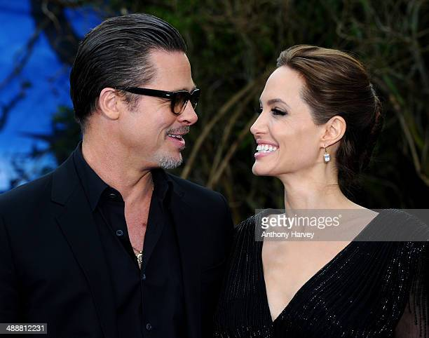 Brad Pitt and Angelina Jolie attend a private reception as costumes and props from Disney's 'Maleficent' are exhibited in support of Great Ormond...