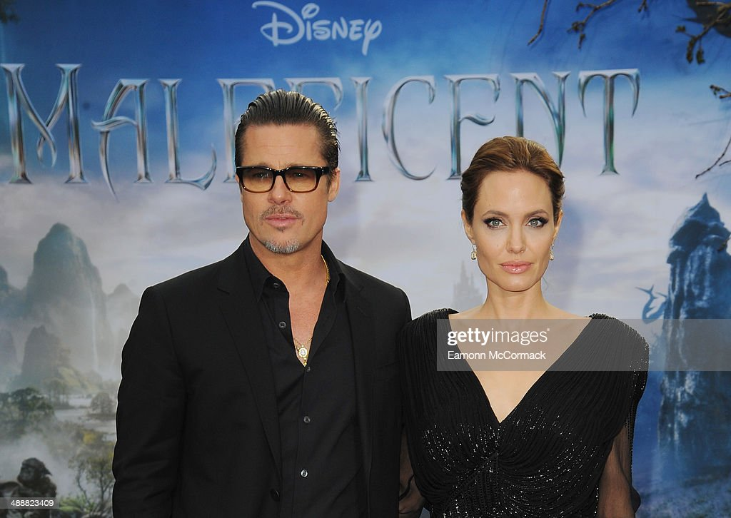 Brad Pitt and Angelina Jolie attend a private reception as costumes and props from Disney's 'Maleficent' are exhibited in support of Great Ormond Street Hospital at Kensington Palace on May 8, 2014 in London, England.