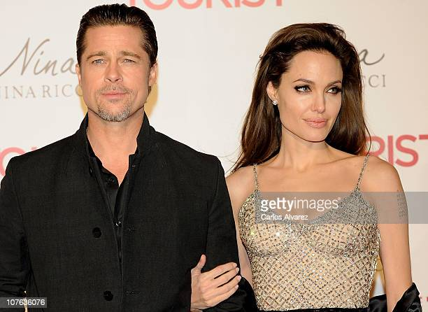 Brad Pitt and Angelina Jolie attend The Tourist premiere at Palacio de los Deportes on December 16 2010 in Madrid Spain