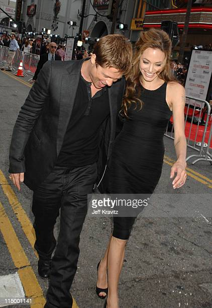 Brad Pitt and Angelina Jolie during 'Ocean's Thirteen' Los Angeles Premiere Red Carpet at Grauman's Chinese Theater in Hollywood California United...