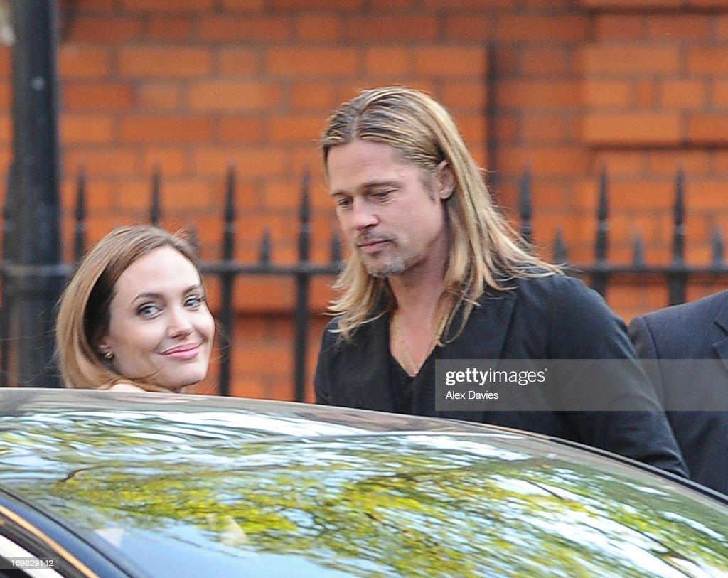 Brad Pitt and Angelina Jolie leave Carlton House on June 2, 2013 in London, England.