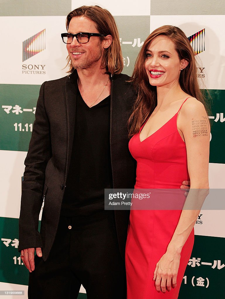 Brad Pitt and Angelina Jolie pose for a photograph on the red carpet during the 'Moneyball' Japan Premiere at Tokyo International Forum on November 9, 2011 in Tokyo, Japan.
