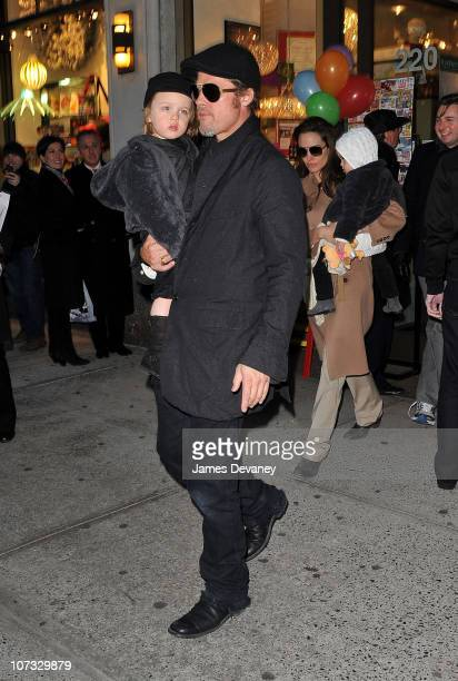 Brad Pitt and Angelina Jolie visit Lee's Art Shop with their children Vivienne JoliePitt and Knox JoliePitt on December 4 2010 in New York City