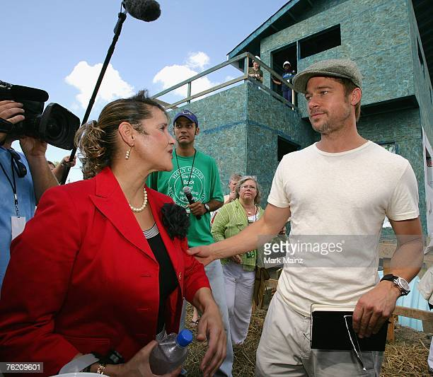 Brad Pitt and council member Cynthia WillardLewis attend a press conference for the Global Green USA's first house project at the Holy Cross...