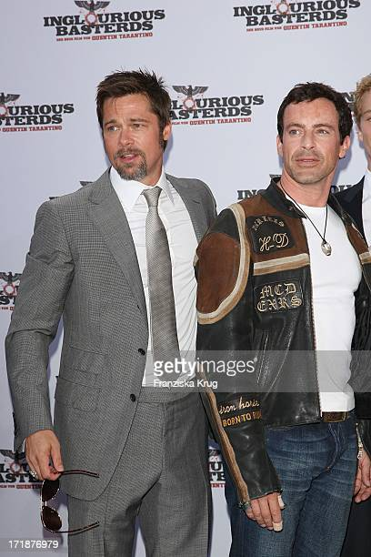 Brad Pitt And Gedeon Burkhard In The Inglourious Basterds premiere in the theater at Potsdamer Platz in Berlin