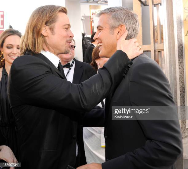 Brad Pitt and George Clooney arrive at The 18th Annual Screen Actors Guild Awards broadcast on TNT/TBS at The Shrine Auditorium on January 29 2012 in...