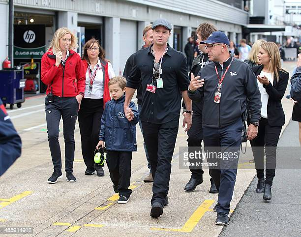 Brad Pitt and his son Knox JoliePitt attend the MotoGP British Grand Prix race at Silverstone ahead of the release of documentary Hitting The Apex...