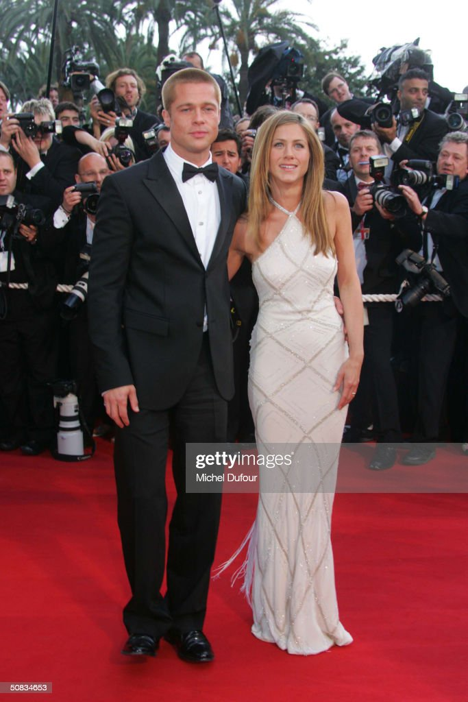Brad Pitt and Jennifer Aniston attend the 57th Cannes Film Festival screening of film 'Troy' at the Grand Theatre Lumiere on May 13, 2004 in Cannes, France. Aniston wears a dress by Versace.