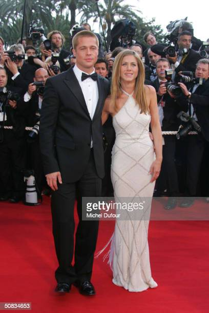 Brad Pitt and Jennifer Aniston attend the 57th Cannes Film Festival screening of film Troy at the Grand Theatre Lumiere on May 13 2004 in Cannes...