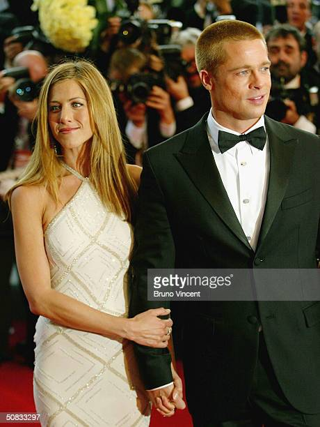 Brad Pitt and Jennifer Aniston attend the World Premiere of epic movie Troy at Le Palais de Festival on May 13 2004 in Cannes France Aniston wears a...