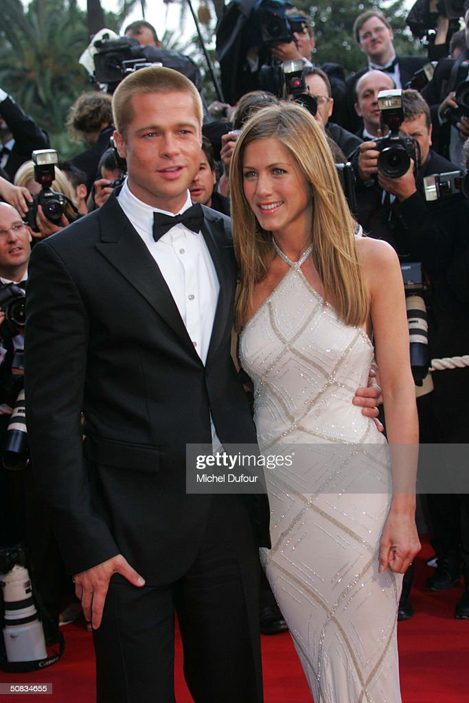 Brad Pitt and Jennifer Aniston attends the 57th Cannes Film Festival screening of film 'Troy' at the Grand Theatre Lumiere on May 13 2004 in Cannes, France. Aniston wears a dress by Versace.