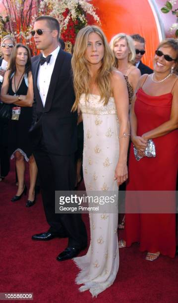 Brad Pitt and Jennifer Aniston during The 56th Annual Primetime Emmy Awards Red Carpet at The Shrine Auditorium in Los Angeles California United...