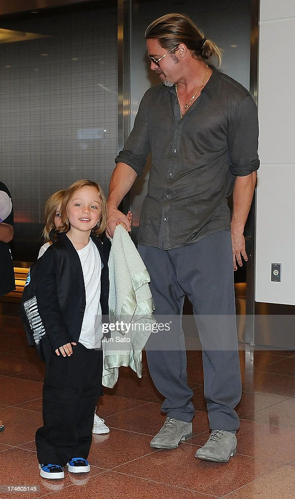 Brad Pitt and Knox Jolie-Pitt arrive at Tokyo International Airport on July 28, 2013 in Tokyo, Japan.