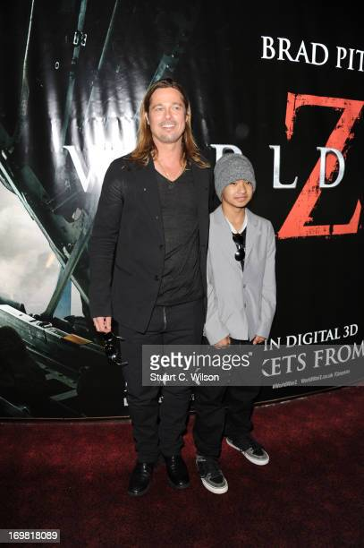 Brad Pitt and Maddox Jolie-Pitt attend the World Premiere of 'World War Z' at The Empire Cinema on June 2, 2013 in London, England.