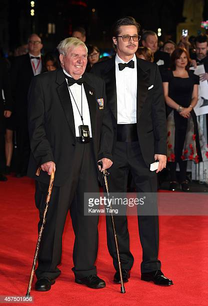 """Brad Pitt and Peter 'Cosy' Comfort attend the closing night Gala screening of """"Fury"""" during the 58th BFI London Film Festival at Odeon Leicester..."""