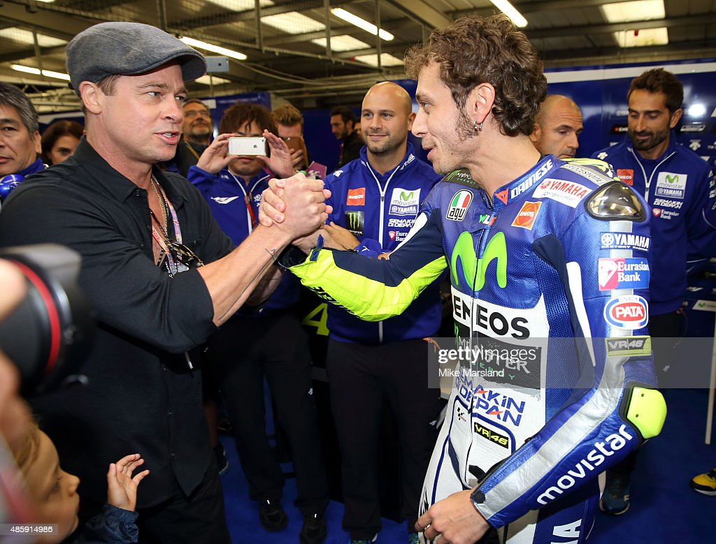 Brad Pitt and Valentino Rossi attend the MotoGP British Grand Prix race at Silverstone ahead of the release of documentary Hitting The Apex. Pitt is presenting the film, which is out in cinemas 2nd September and on DVD 7th September at Silverstone Circuit on August 30, 2015 in Northampton, England