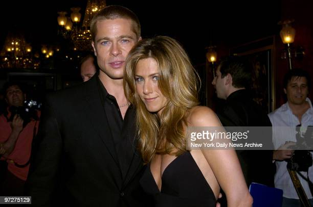 Brad Pitt and wife Jennifer Aniston attend the US premiere of the movie Troy at the Ziegfeld Theater He stars in the film