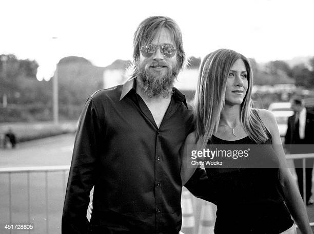Brad Pitt and wife Jennifer Aniston during The Good Girl Los Angeles Industry Screening Arrivals Black and White Photography by Chris Weeks at...