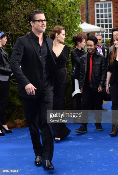 """Brad Pitt, Angelina Jolie and Maddox Jolie-Pitt attend a private reception as costumes and props from Disney's """"Maleficent"""" are exhibited in support..."""