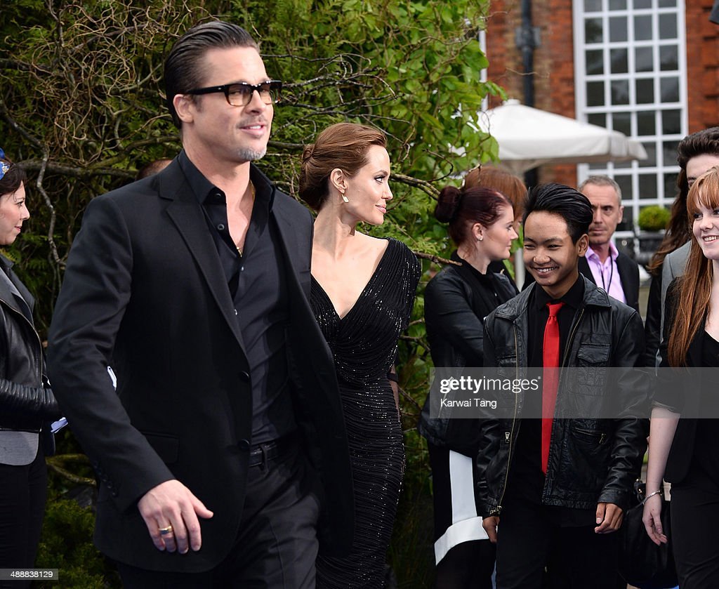 Brad Pitt, Angelina Jolie and Maddox Jolie-Pitt attend a private reception as costumes and props from Disney's 'Maleficent' are exhibited in support of Great Ormond Street Hospital held at Kensington Palace on May 8, 2014 in London, England.