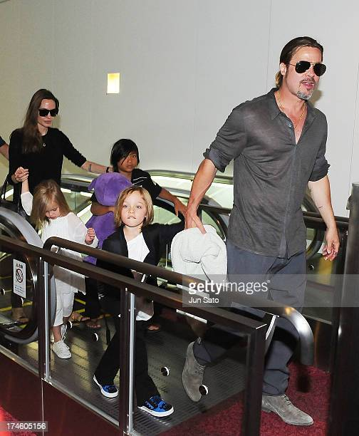Brad Pitt Angelina Jolie and their children Knox JoliePitt Pax JoliePitt and Vivienne JoliePitt arrive at Tokyo International Airport on July 28 2013...