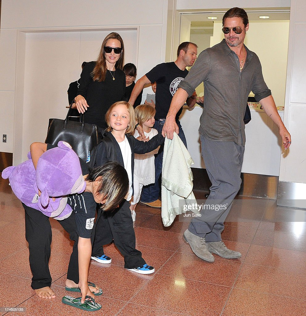Brad Pitt, Angelina Jolie and their children Pax, Knox and Vivienne arrive at Tokyo International Airport on July 28, 2013 in Tokyo, Japan.