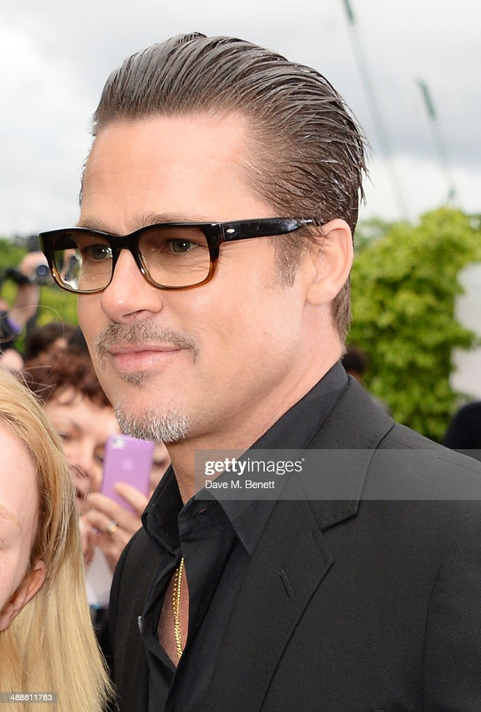 Brad Pitt arrives at a private reception as costumes and props from Disney's 'Maleficent' are exhibited in support of Great Ormond Street Hospital at Kensington Palace on May 8, 2014 in London, England.