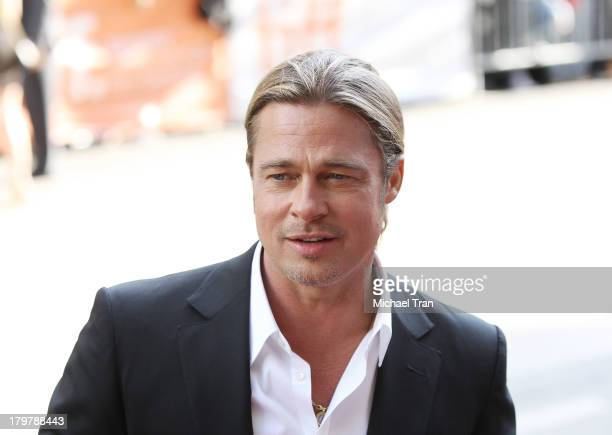 Brad Pitt arrives at the 12 Years A Slave premiere during the 2013 Toronto International Film Festival held at Princess of Wales Theatre on September...